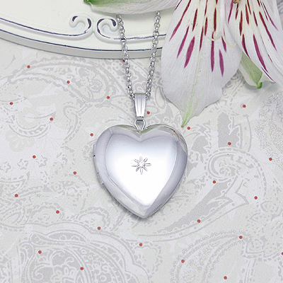 Beautiful polished sterling heart locket set with a genuine diamond. The locket necklace comes on an 18 inch sterling chain.