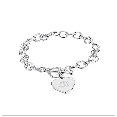 Sterling silver charm bracelets with included heart charm and personalized engraving.
