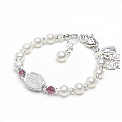 Cultured pearl baby and childrens bracelet with sparkling diamond-cut sterling and genuine birthstone beads.