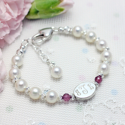 Gorgeous pearl bracelet with genuine birthstones and sparkly diamond cut sterling.