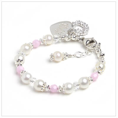 Cultured pearl bracelet for babies and children with baby pink crystals and engraved heart charm included.