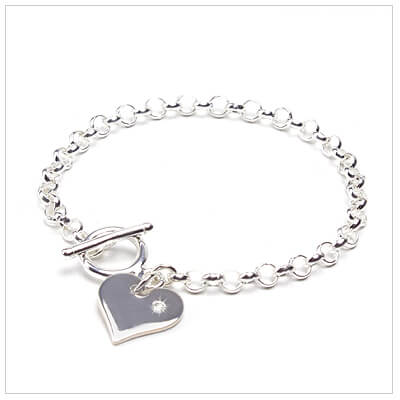 Baby bracelet with diamond heart charm and toggle clasp.