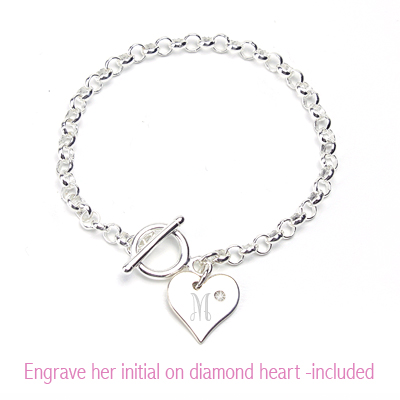 Toggle style baby bracelet in sterling silver with diamond heart charm.