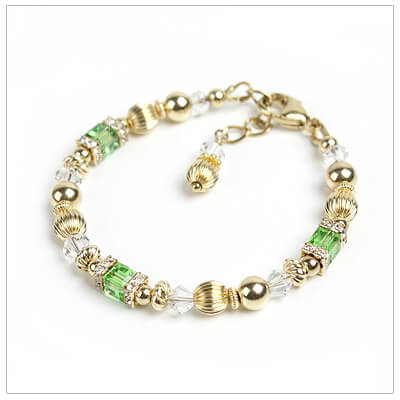 Baby and childrens bracelets in 14kt gold filled and Swarovski cube crystal birthstones (August shown).