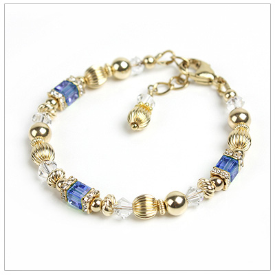 Baby and children's bracelets in 14kt gold filled and Swarovski cube crystal birthstones (September shown).