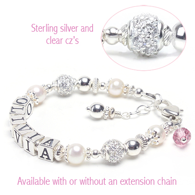 Personalized baby name bracelet in white pearls with sparkling cz beads and free birthstone charm.