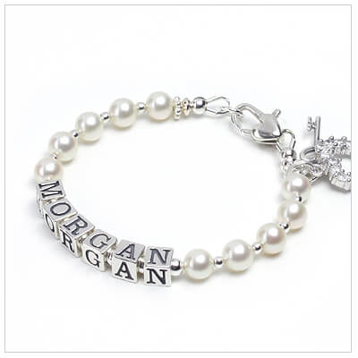 Baby bracelet in white cultured pearls and sterling letter blocks.