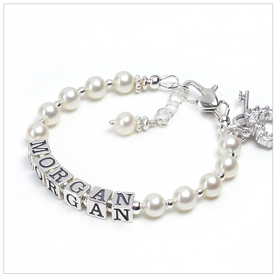 Beautiful white pearl baby bracelet personalized with name.