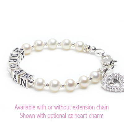 Cultured pearl baby bracelet with personalized name in sterling silver.