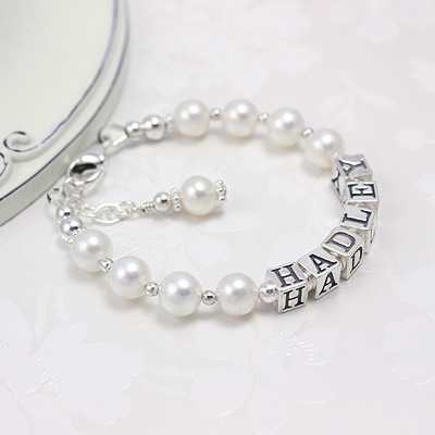 Classic baby bracelets in beautiful round cultured pearls and sterling silver.