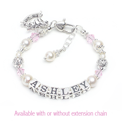 Baby and child bracelet personalized with name in cultured pearls, soft pink crystal, and sterling filigree beads.
