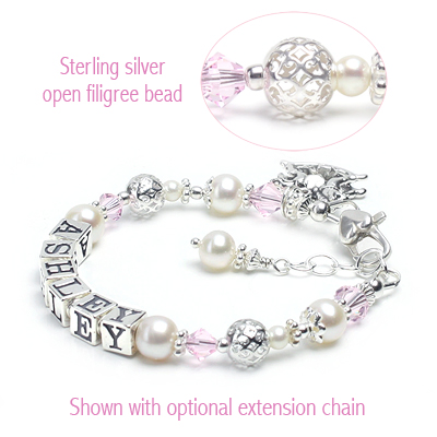 Baby bracelet personalized with name in cultured pearls, Swarovski crystal, and silver filigree beads.