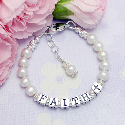 Perfect baby bracelets for Baptisms or Baby Dedications, Simplicity has cultured pearls and a Cross bead instead of a charm.