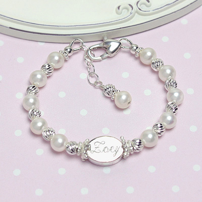 Baby bracelet and children%27s bracelet with white cultured pearls, twisted sterling beads and custom engraving.
