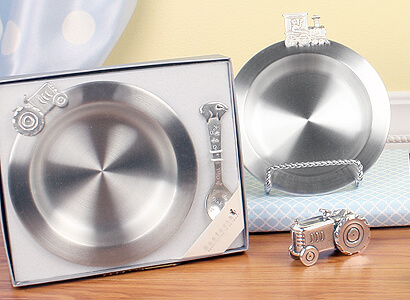 Baby boy gifts; pewter bowls with matching spoons. Tractor and pig feeding set and train feeding set.