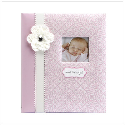 Beautiful baby memory book for little girls with pearlized pink paper, ribbon, flower, and customizable picture window on cover. 60 pages of recording babys first milestones for her first 5 years. Acid-free and lignin-free.