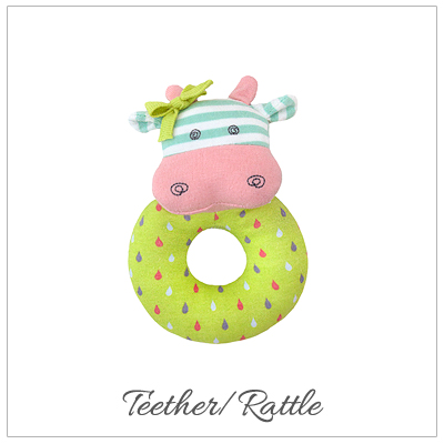 Belle the Cow baby teether rattle. Our baby gift is 100% organic cotton and hypoallergenic.