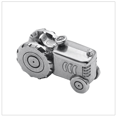 Precious baby gift finely crafted in pewter, a miniture tractor with lift-off lid revealing small compartment. Boys tooth fairy box.