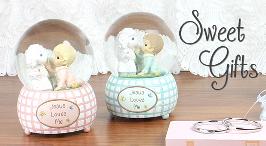 New baby gifts, sweet boy or girl water globes by Precious Moments and sterling silver baby bracelets. A variety of gifts perfect for baby shower gifts.