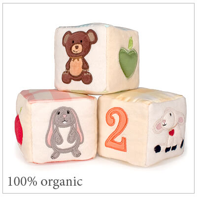 Adorable soft blocks for babies and toddlers in 100% organic cotton and natural silk. Each block has its own sound: bell, rattle, or squeak.