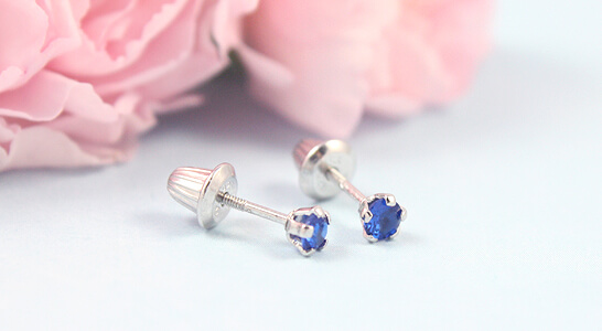 Baby and infant birthstone earrings in sterling silver with screw backs. September birthstone earrings shown.