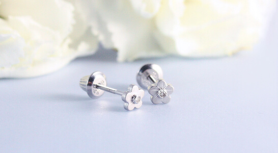 Sterling silver baby diamond earrings in a charming flower design. Our diamond earrings are screw back earrings for babies and toddlers.