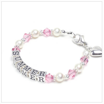 Baby name bracelets with white cultured pearls and sweet pink crystals.