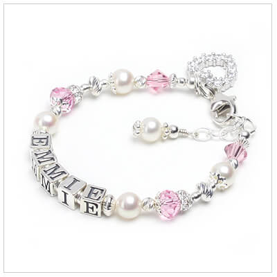 Baby and child bracelet in pearls and sparkling crystals, personalized with name.
