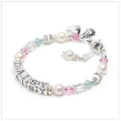 Baby and childrens personalized bracelet in soft springtime colors.