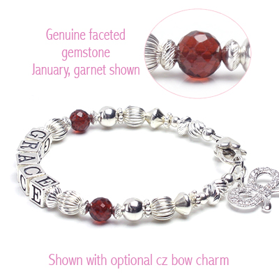 Personalized baby name bracelet in sterling silver with genuine birthstones.