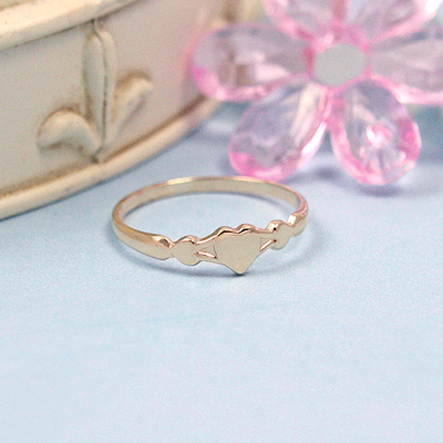 10kt gold baby ring with three tiny hearts.