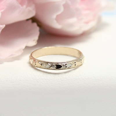 10kt Heart Band Baby Rings with an embossed pattern of hearts all