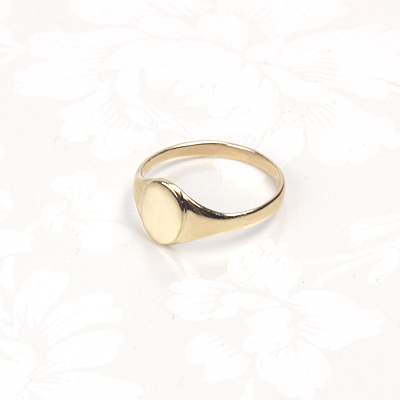 14kt yellow gold signet ring for babies. The baby ring is a size one.