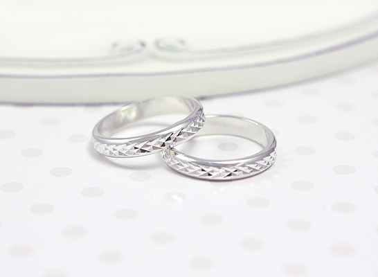 Baby and child's diamond-cut band rings in sterling silver.