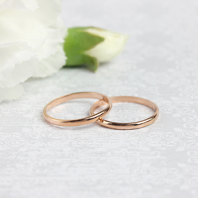 14kt rose gold band ring for children.