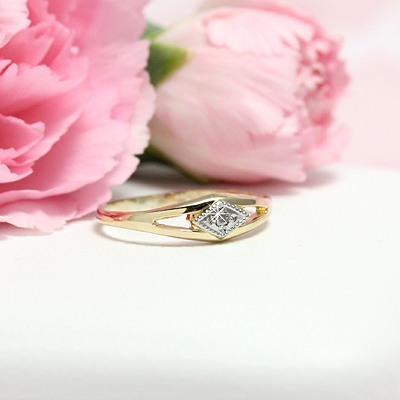 Gold baby ring with genuine diamond; fits babies and toddlers.