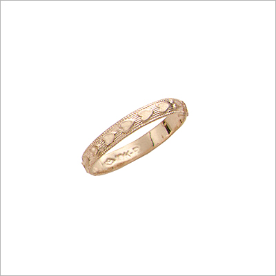 14kt Gold Heart Band Baby Rings with embossed hearts around the