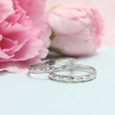 Sterling silver baby rings with a border of hearts all around the band.