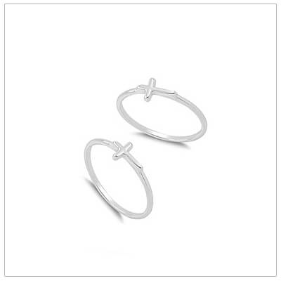 Tiny sideways Cross rings in sterling silver for babies and toddlers.
