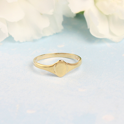10kt gold oval signet ring for babies and toddlers.