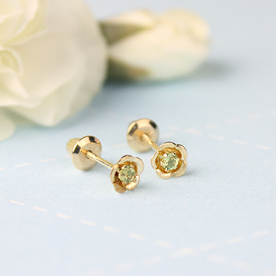 14kt gold August birthstone earrings with a flower shape. Beautiful birthstone earrings for babies and children.