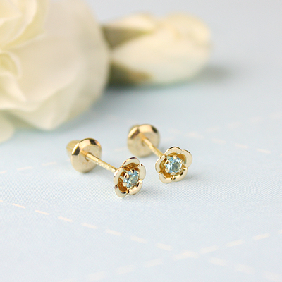 14kt gold December birthstone earrings with a flower shape. Beautiful birthstone earrings for babies and children.