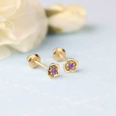 February birthstone earrings for children in 14kt yellow gold. Baby and childrens birthstone earrings in a flower shape.