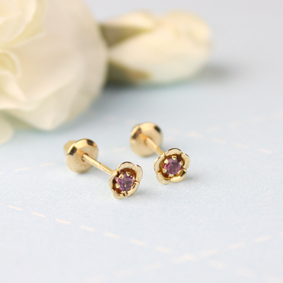 14kt gold June birthstone earrings with a flower shape. Beautiful birthstone earrings for babies and children.