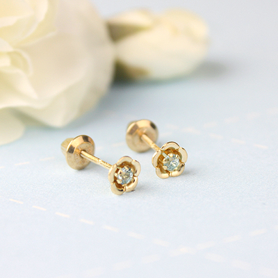 14kt gold March birthstone earrings with a flower shape. Beautiful birthstone earrings for babies and children.
