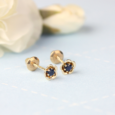14kt gold September birthstone earrings with a flower shape. Beautiful birthstone earrings for babies and children.