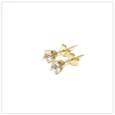 14kt gold April birthstone earrings, classic stud earrings with a push on back.