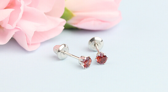 Birthstone earrings in 14kt white gold with screw backs. Screw back birthstone earrings with genuine birthstones for girls.