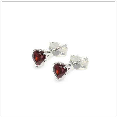 January heart shaped birthstone earrings in sterling silver for children and teens. These birthstone earrings have a decorative basket setting with three prongs.