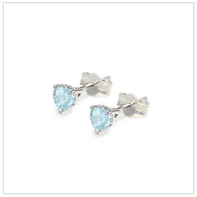 March heart shaped birthstone earrings in sterling silver for children and teens. These birthstone earrings have a decorative basket setting with three prongs.